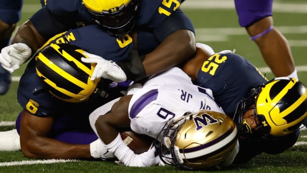 Richard Newton is gang-tackled by Michigan.
