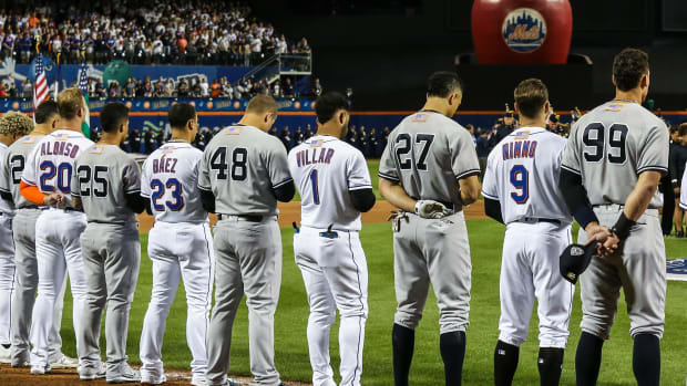 Sep 11, 2021; New York City, New York, USA; Members of the New York Yankees and New York Mets line up next to each other during the September 11 pre-game ceremonies at Citi Field.