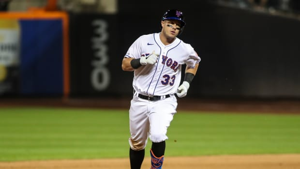 Sep 11, 2021; New York City, New York, USA; New York Mets catcher James McCann (33) rounds the bases after hitting a two run home run in the sixth inning against the New York Yankees at Citi Field.