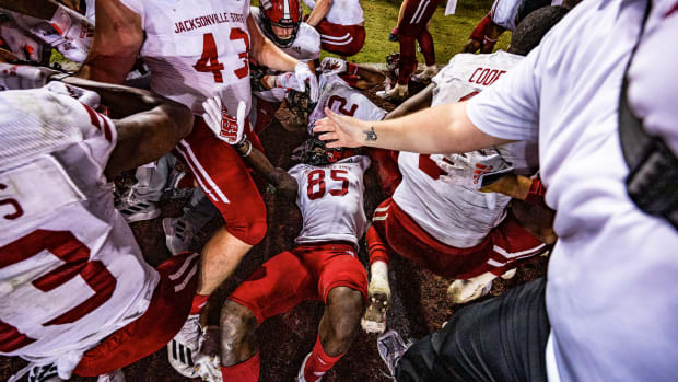 Jacksonville State receiver Damond Philyaw-Johnson is at the bottom of a celebratory dogpile.