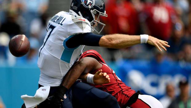 Tennessee Titans quarterback Ryan Tannehill (17) is sacked by Arizona Cardinals middle linebacker Chandler Jones (55) during the first quarter at Nissan Stadium Sunday, Sept. 12, 2021 in Nashville, Tenn.