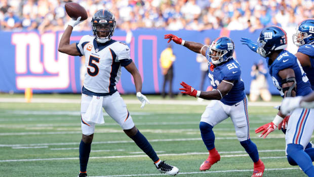 Denver Broncos quarterback Teddy Bridgewater (5) throws the ball against the New York Giants during the first quarter at MetLife Stadium.