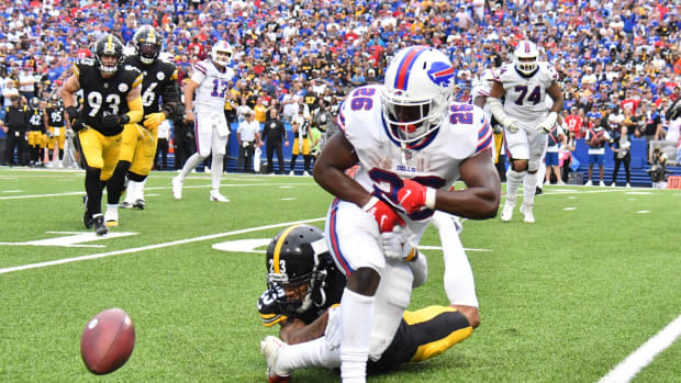 Buffalo Bills running back Devin Singletary (26) fumbles the ball out of bounds on a tackle by Pittsburgh Steelers cornerback Joe Haden.