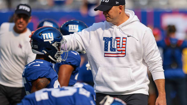 Sep 12, 2021; East Rutherford, New Jersey, USA; New York Giants head coach Joe Judge talks with cornerback Rodarius Williams (25) before the game against the Denver Broncos at MetLife Stadium.