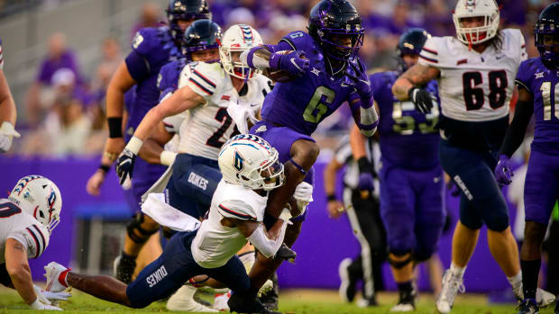 Sep 4, 2021; Fort Worth, Texas, USA; TCU Horned Frogs running back Zach Evans (6) runs for a first down against the Duquesne Dukes during the first quarter at Amon G. Carter Stadium.