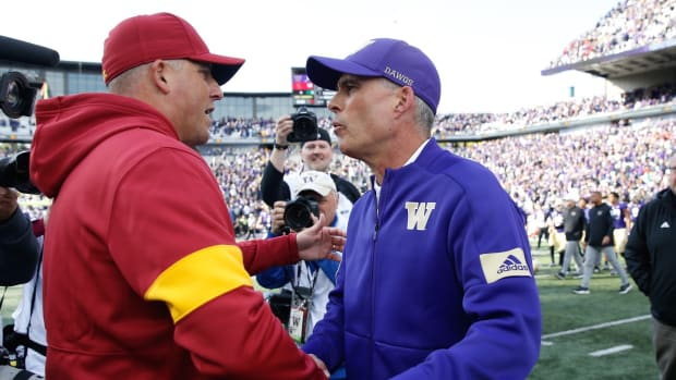 Clay Helton and Chris Petersen meet after their game in 2019.