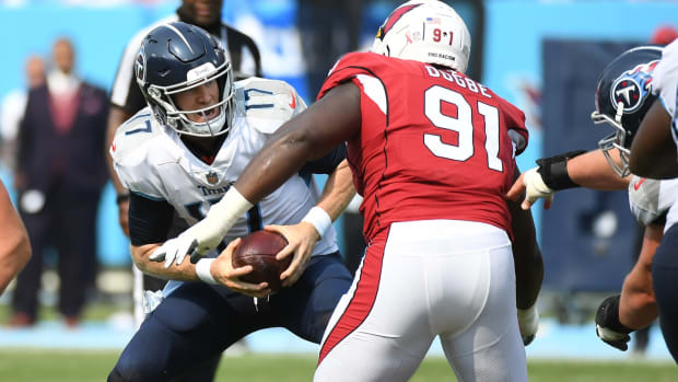 Tennessee Titans quarterback Ryan Tannehill (17) is sacked by Arizona Cardinals defensive end Michael Dogbe (91) during the second half at Nissan Stadium.