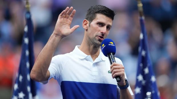 Novak Djokovic holding a mike at the 2021 U.S. Open