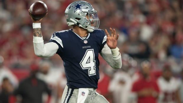 Sep 9, 2021; Tampa, Florida, USA; Dallas Cowboys quarterback Dak Prescott (4) throws the ball against the Tampa Bay Buccaneers during the first half at Raymond James Stadium.