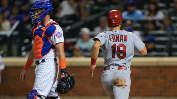 Sep 13, 2021; New York City, New York, USA; St. Louis Cardinals second baseman Tommy Edman (19) scores a run on St. Louis Cardinals first baseman Paul Goldschmidt (46) (not pictured) RBI single against the New York Mets during the third inning at Citi Field.