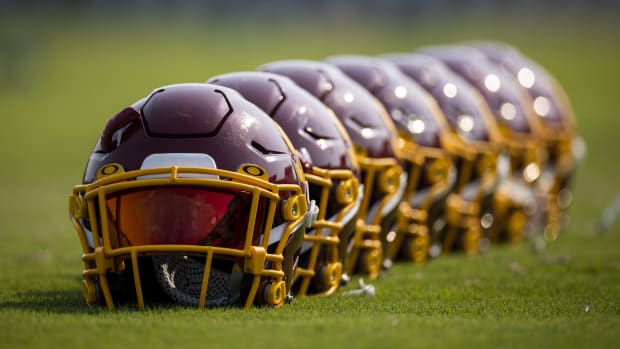 Jul 29, 2021; Richmond, VA, USA; A row of Washington Football Team helmets are seen on the field during training camp at Bon Secours Washington Football Team Training Center.