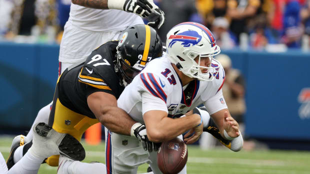 Bills quarterback Josh Allen fumbles while being tackled by Steelers Cameron Heyward. Allen recovered.