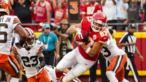 Sep 12, 2021; Kansas City, Missouri, USA; Kansas City Chiefs tight end Travis Kelce (87) scores a touchdown against the Cleveland Browns during the second half at GEHA Field at Arrowhead Stadium. Mandatory Credit: Jay Biggerstaff-USA TODAY Sports