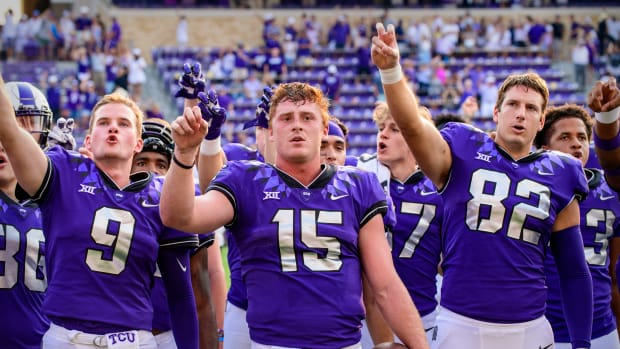Sep 11, 2021; Fort Worth, Texas, USA; TCU Horned Frogs quarterback Luke Pardee (9) and quarterback Max Duggan (15) and tight end Mitchell Hansen (82) sing the school alma mater after the win over the California Golden Bears at Amon G. Carter Stadium.