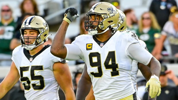 Cameron Jordan of the Saints and defensive teammates take the field