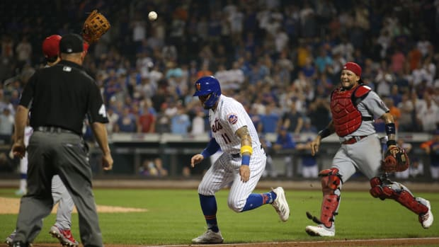 Sep 14, 2021; New York City, New York, USA; New York Mets center fielder Kevin Pillar (11) is caught in a run down by St. Louis Cardinals catcher Yadier Molina (right) and third baseman Nolan Arenado (left) during the tenth inning at Citi Field.