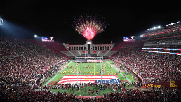Sep 11, 2021; Los Angeles, California, USA; A general overall view of a United States flag and fireworks during the playing of the national anthem before a game between the Southern California Trojans and the Stanford Cardinal at United Airlines Field at Los Angeles Memorial Coliseum.