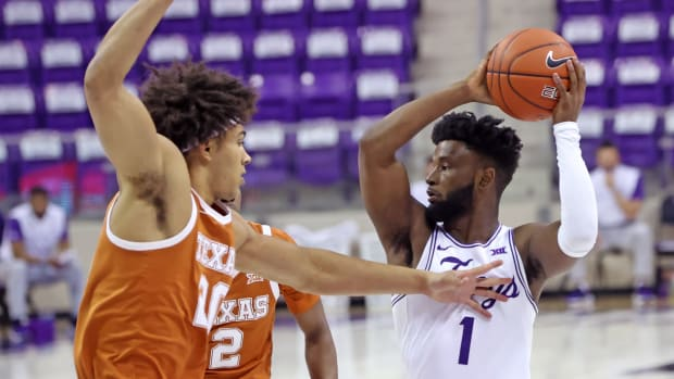Mar 7, 2021; Fort Worth, Texas, USA; TCU Horned Frogs guard Mike Miles (1) looks to pass as Texas Longhorns forward Jericho Sims (20) defends during the first half at Ed and Rae Schollmaier Arena.