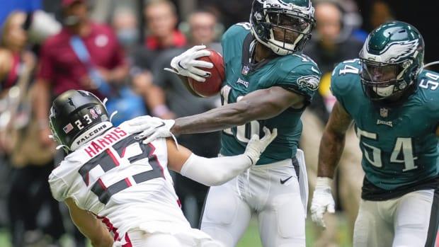 Jalen Reagor returns a punt against the Falcons