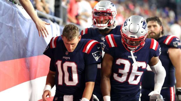 Patriots QB Mac Jones (10) and LB Brandon King (36)
