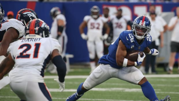 Saquon Barkley of the Giants runs the ball in the fourth quarter as the Denver Broncos came to MetLife Stadium in East Rutherford, NJ and beat the New York Giants 27-13 in the first game of the 2021 season on September 12, 2021.