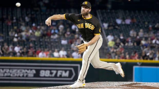 Aug 15, 2021; Phoenix, Arizona, USA; San Diego Padres relief pitcher Austin Adams (54) throws against the Arizona Diamondbacks in the ninth inning at Chase Field.