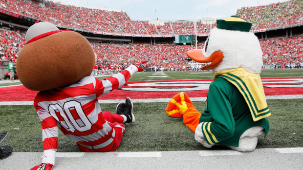 The Ohio State and Oregon mascots take in Saturday's game in Columbus