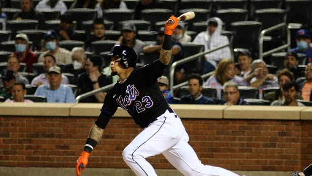 Sep 10, 2021; New York City, New York, USA; New York Mets second baseman Javier Baez (23) hits an RBI single against the New York Yankees during the first inning at Citi Field.