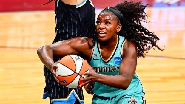 Michaela Onyenwere drives to the basket