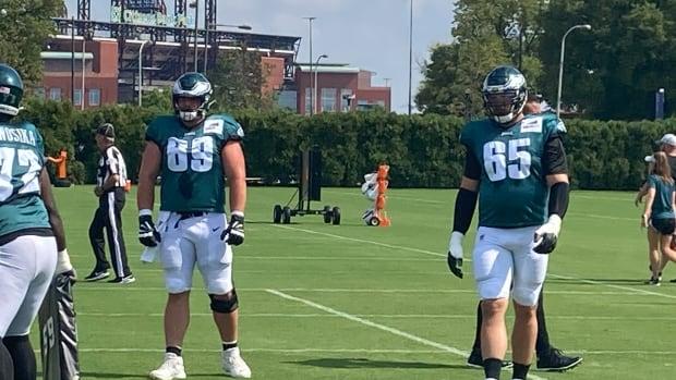 Eagles OL Landon Dickerson (left) and Lane Johnson practice on Sept. 15, 2021