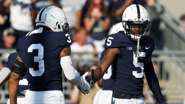 Penn State's Jahan Dotson is congratulated by WR Parker Washington