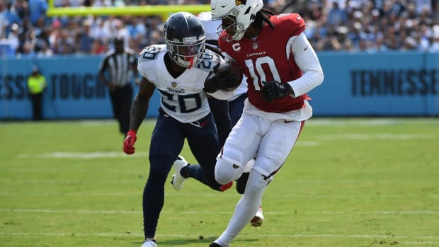 Arizona Cardinals wide receiver DeAndre Hopkins (10) is covered by Tennessee Titans cornerback Jackrabbit Jenkins (20) during the first half at Nissan Stadium.