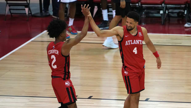 Atlanta Hawks guard Sharife Cooper (2) celebrates with guard Skylar Mays (4) after scoring the game winning basket against the Indiana Pacers to give the Hawks a 84-83 victory during an NBA Summer League game at Cox Pavilion.
