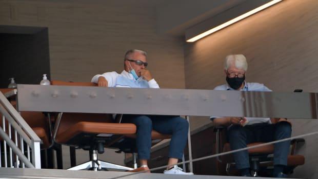 Jul 7, 2020; Kansas City, Missouri, United States; Kansas City Royals general manager Dayton Moore (left) and principle owner John Sherman watch during an intrasquad game at Kauffman Stadium. Mandatory Credit: Denny Medley-USA TODAY Sports