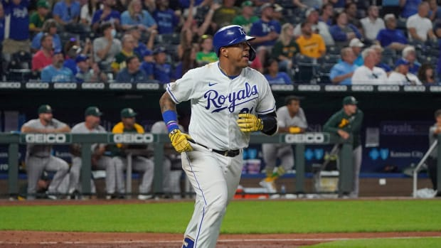 Sep 15, 2021; Kansas City, Missouri, USA; Kansas City Royals catcher Salvador Perez (13), wearing number 21, hits a solo home run against the Oakland Athletics in the fifth inning at Kauffman Stadium.