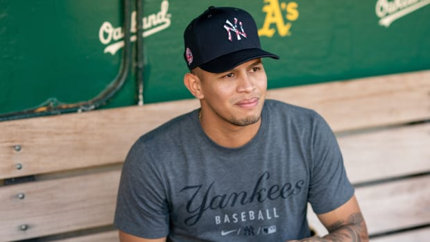 Yankees RP Jonathan Loaisiga smiling in dugout