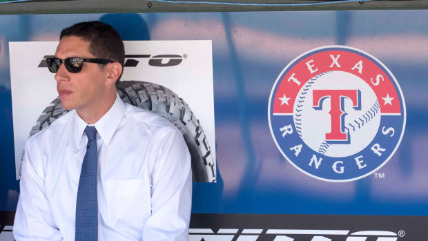 Apr 3, 2017; Arlington, TX, USA; Texas Rangers general manager Jon Daniels watches batting practice before the game between the Rangers and the Cleveland Indians at Globe Life Park in Arlington.