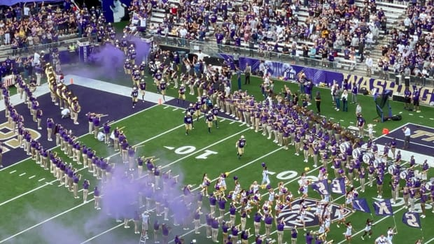 UW players enter the field for the Montana game.