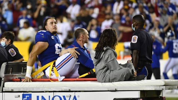 Sep 16, 2021; Landover, Maryland, USA; New York Giants center Nick Gates (65) reacts after suffering an apparent leg injury against the Washington Football Team during the first half at FedExField.