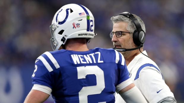 Indianapolis Colts quarterback Carson Wentz (2) talks with head coach Frank Reich on Sunday, Sept. 12, 2021, during the regular season opener against the Seattle Seahawks at Lucas Oil Stadium in Indianapolis