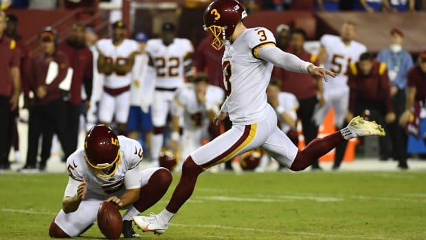 Sep 16, 2021; Landover, Maryland, USA; Washington Football Team place kicker Dustin Hopkins (3) kicks the game winning field goal against the New York Giants during the second half at FedExField.