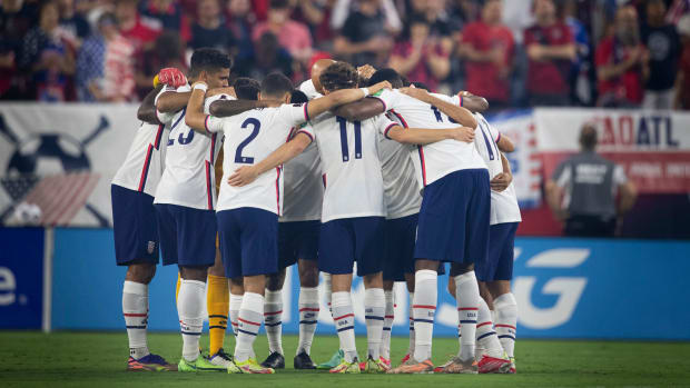 The USMNT huddles during a World Cup qualifier