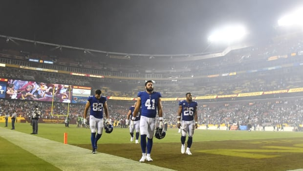 Sep 16, 2021; Landover, Maryland, USA; New York Giants players walk off the field walks off the field after a loss to the Washington Football Team at FedExField.