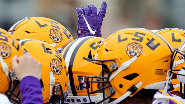 Apr 17, 2021; Baton Rouge, Louisiana, USA; LSU Tigers huddle during warm ups before the annual Purple and White spring game at Tiger Stadium.