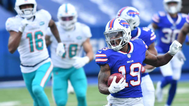 Buffalo Bills wide receiver Isaiah McKenzie (19) returns a punt for a touchdown against the Miami Dolphins last January.