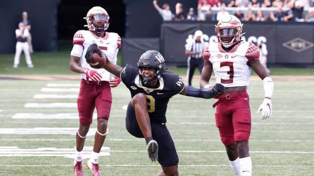 Wake Forest wide receiver A.T. Perry (9) celebrates a first down catch with FSU defensive backs Brendan Gant (5) and Jarvis Brownlee Jr. (3) in the background.