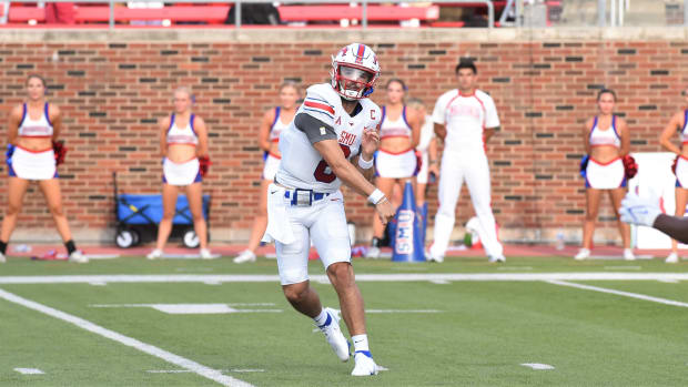 SMU quarterback Tanner Mordecai (8) lets go of a pass during Saturday's game against ACU at Gerald J. Ford Stadium in Dallas on Sept. 4, 2021. Mordecai threw an SMU-record seven touchdowns as the Mustangs won 56-9.