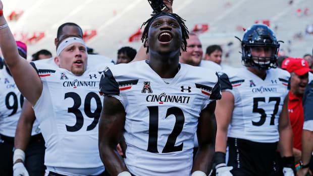 Cincinnati Bearcats players celebrate the win at Indiana