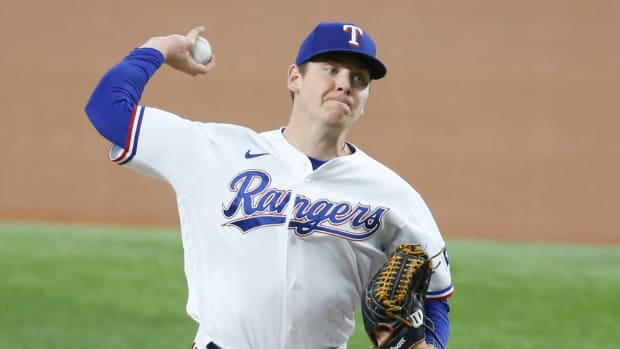 Sep 18, 2021; Arlington, Texas, USA; Texas Rangers starting pitcher Spencer Howard (31) throws a pitch in the first inning against the Chicago White Sox at Globe Life Field.