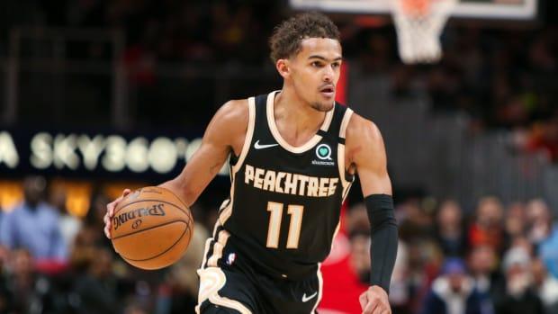 Atlanta Hawks guard Trae Young (11) dribbles against the Miami Heat
